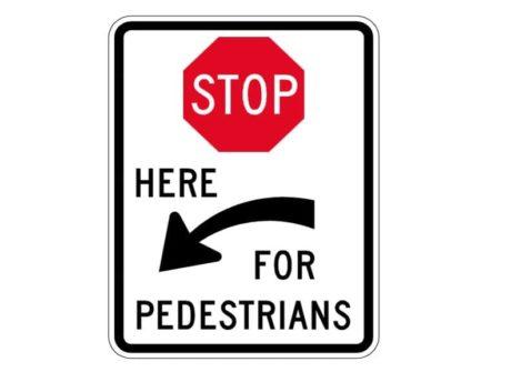 R1-5cL Stop Here for Pedestrians Left Arrow Sign